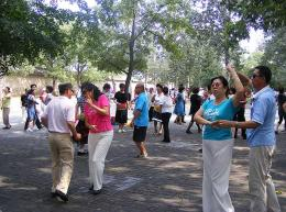People dancing in the park of Summer Palace, Beijing, China